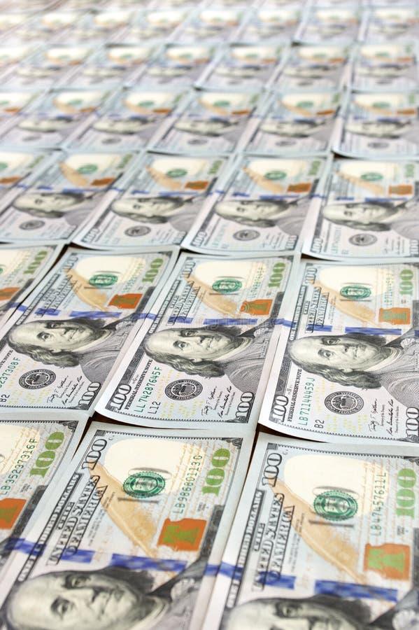 Filas de los nuevos billetes de dólar del diseño imagen de archivo libre de regalías