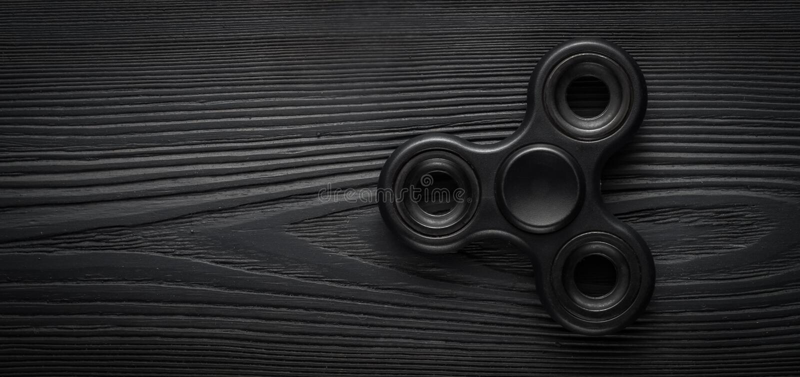 Filatore più importante del nero del wiew su un fondo nero fotografia stock