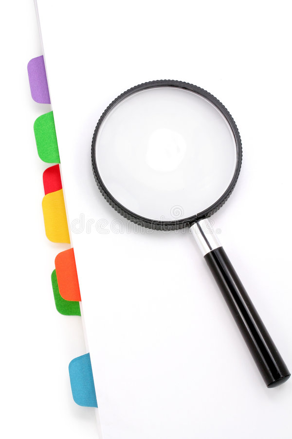 File divider and magnifier stock photography