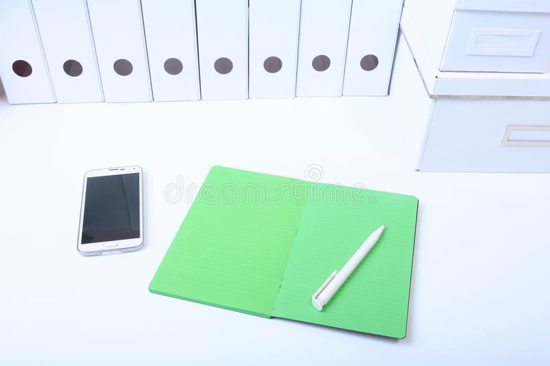 File folder with documents and important document with phone and notebook on background.  stock images