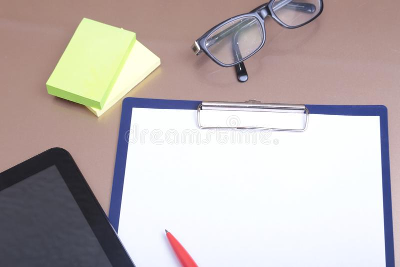 File folder with documents and important document with phone and notebook on background.  royalty free stock photography