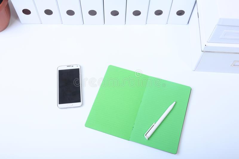 File folder with documents and important document with phone and notebook on background.  royalty free stock images
