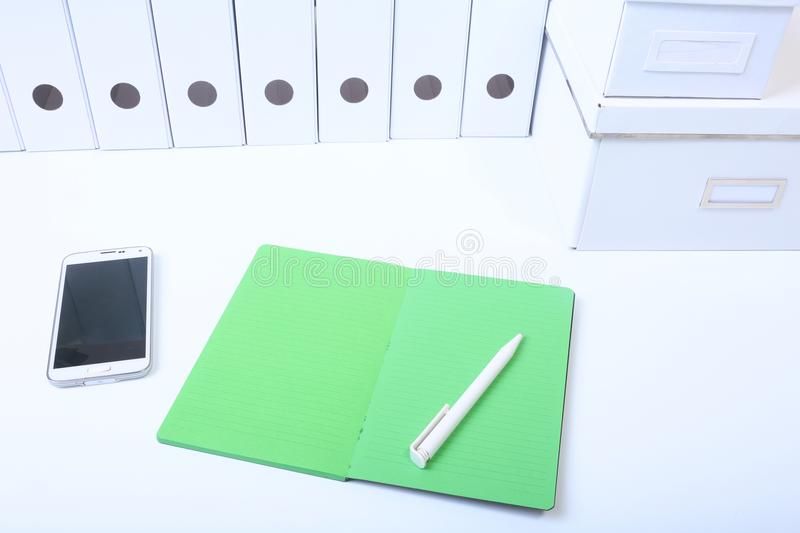 File folder with documents and important document with phone and notebook on isolated background.  stock image