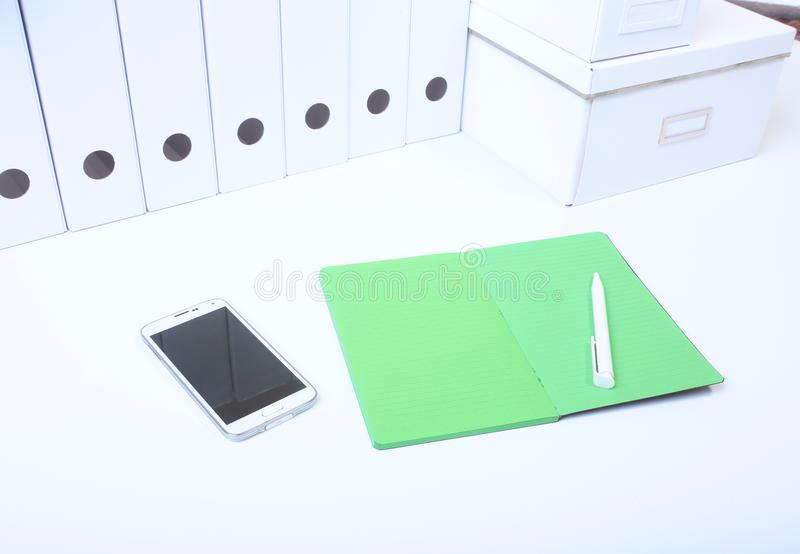 File folder with documents and important document with phone and notebook on isolated background.  royalty free stock photos