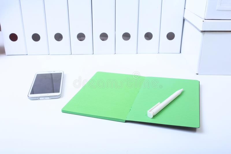 File folder with documents and important document with phone and notebook on isolated background.  stock photography