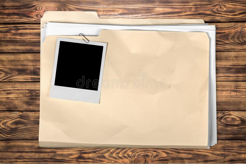 Yellow file folder on wooden background royalty free stock photo