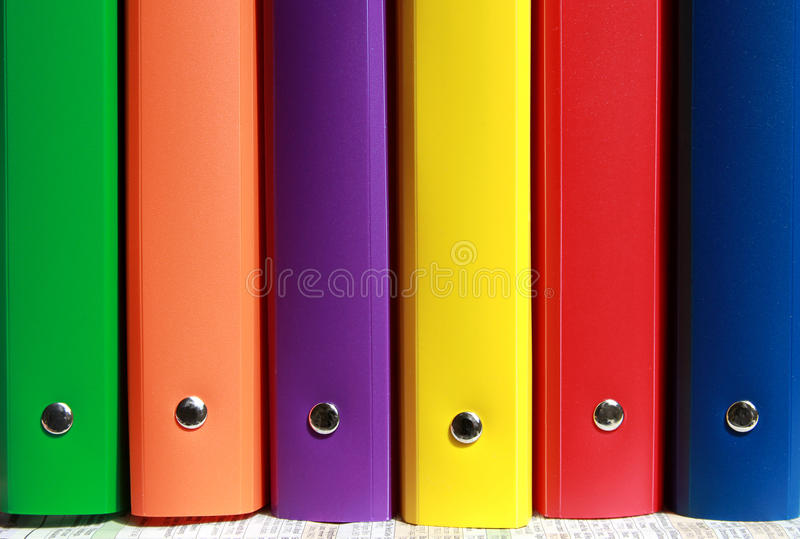 File folders. Colorful file folders with metal pin standing in a row royalty free stock photos