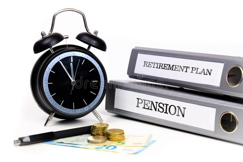File folders and alarm clock symbolize time pressure while working on retirement plan and pension.  stock photo