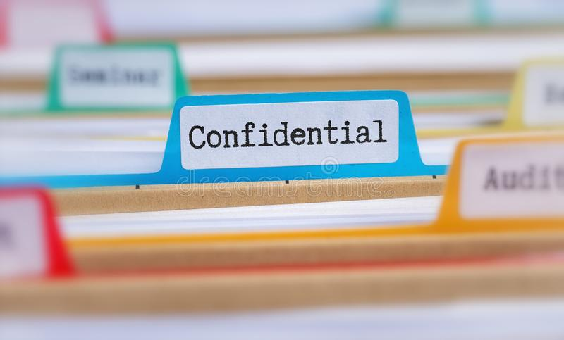 File folders with a tab labeled Confidential stock photography