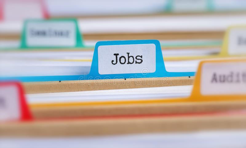 File folders with a tab labeled Jobs stock photos