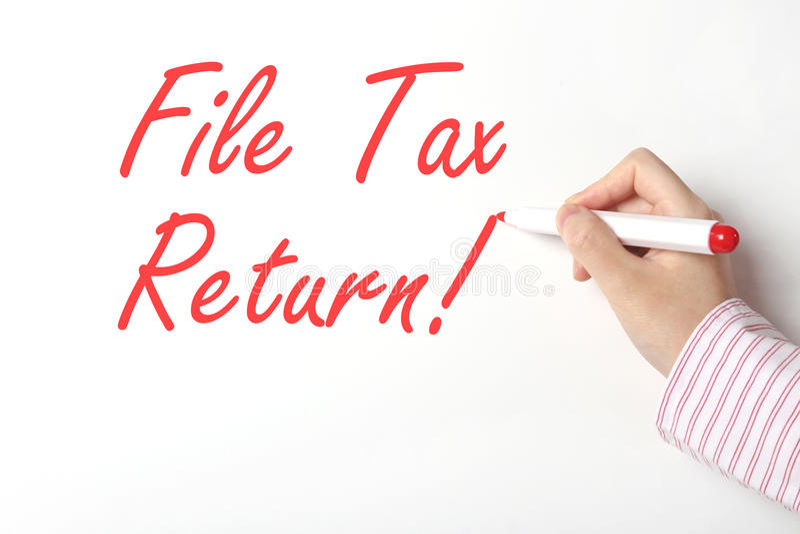 File tax return. On whiteboard stock image