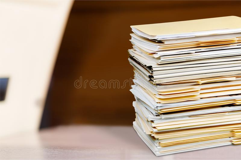 Filed Documents. Stack Paperwork Isolated Office Busy Stacking royalty free stock photos