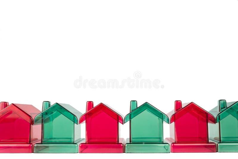 Fileira de casas plásticas foto de stock royalty free