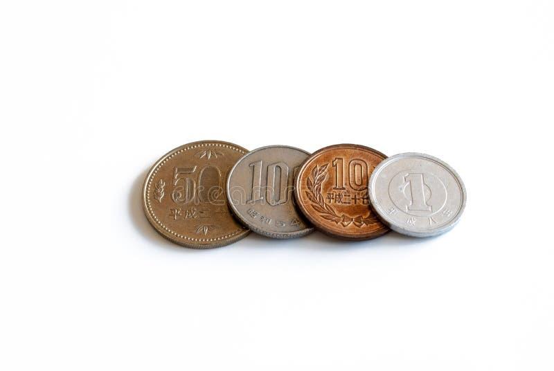 Fileira de moedas japonesas em seguido imagem de stock