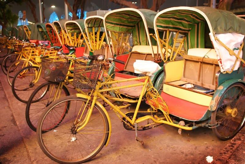 Fileira do trishaw, Macau fotografia de stock