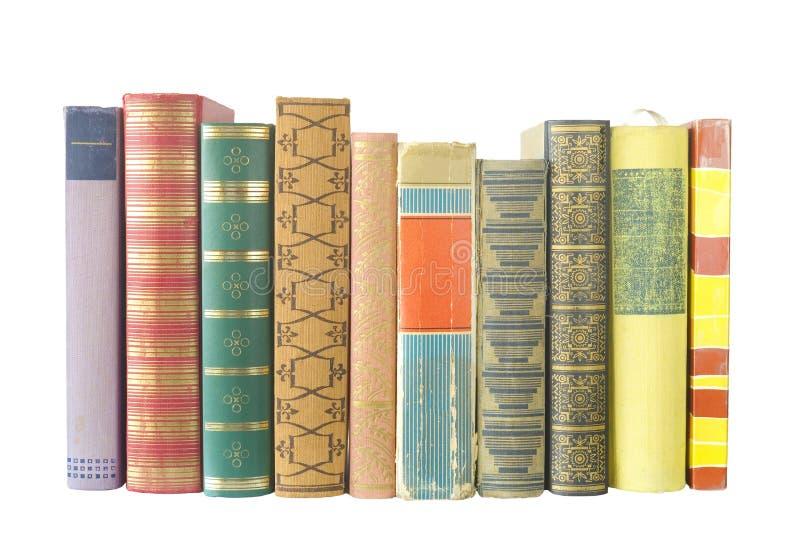 Fileira dos livros isolados foto de stock