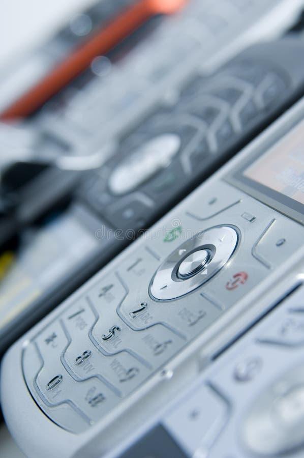 Fileira dos telefones fotos de stock