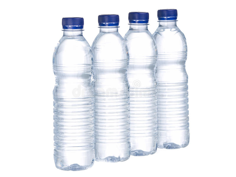 Fileiras das garrafas de água imagens de stock