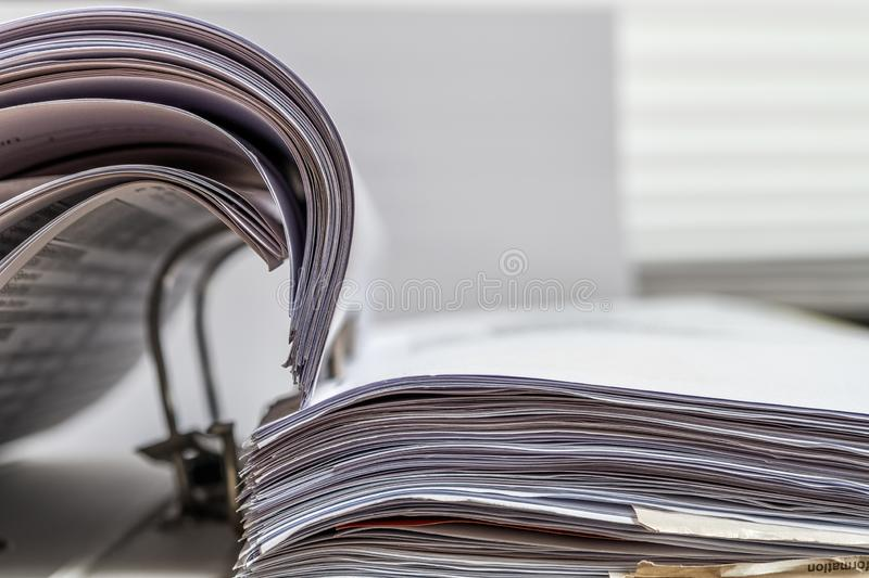 Files folder on desk white. Files folder with white paper on office desk royalty free stock photography