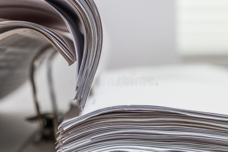 Files folder on white desk. Files folder with white paper on office desk royalty free stock photography