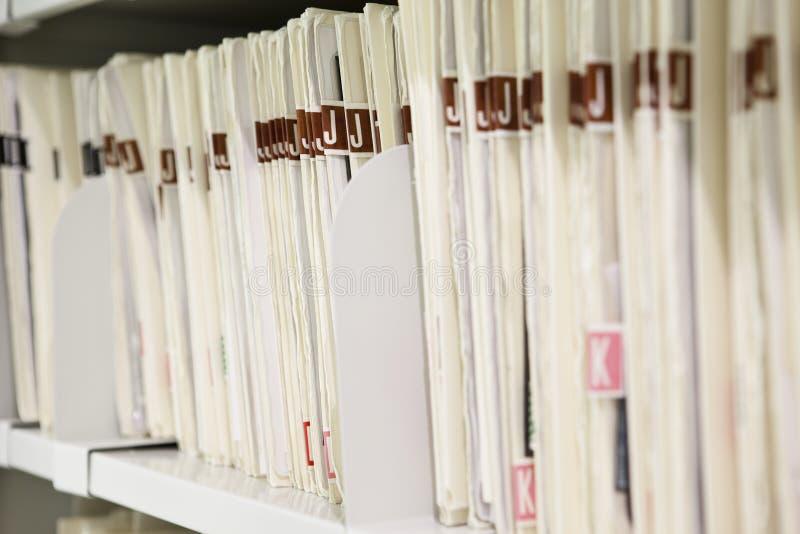 Files organized on shelf royalty free stock photo