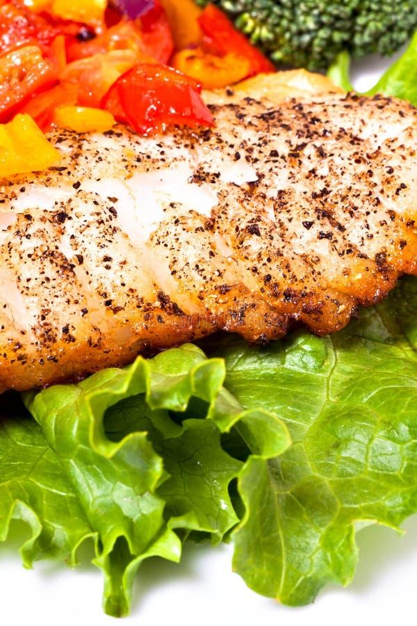 Filet et légumes de poissons photo stock