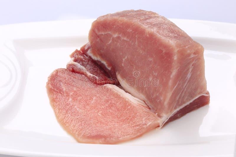 Filet maigre de porc d'un plat blanc photos libres de droits