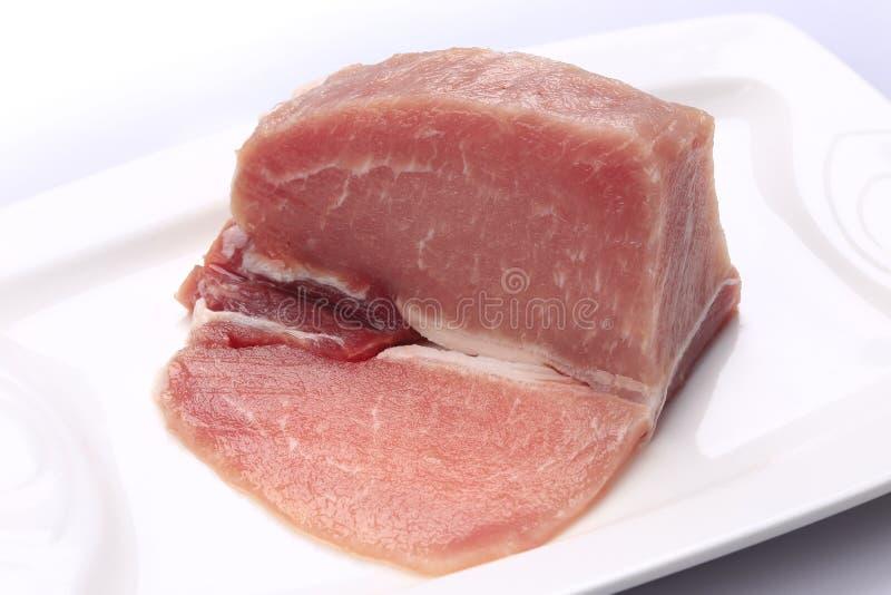 Filet maigre de porc d'un plat blanc photo stock