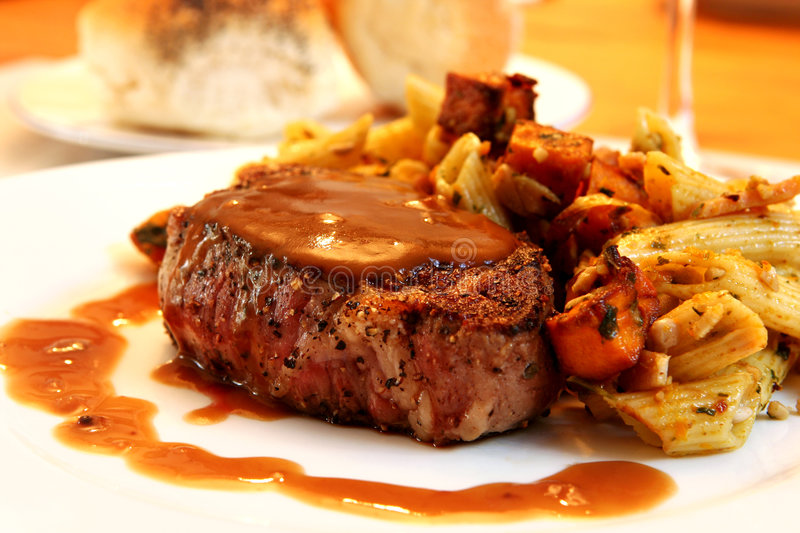 Filet Mignon. Beef steak with pasta vegetable salad stock images