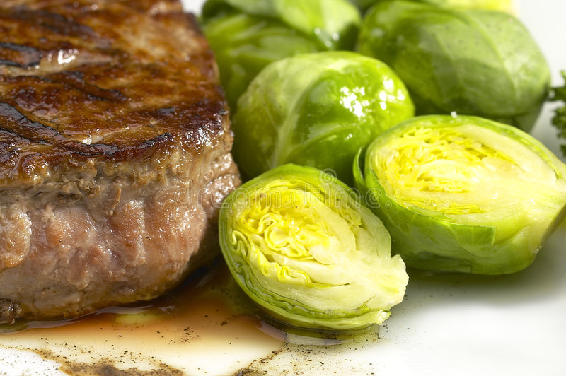 Filet mignon. Juicy filet mignon on plate with brussel sprout stock images