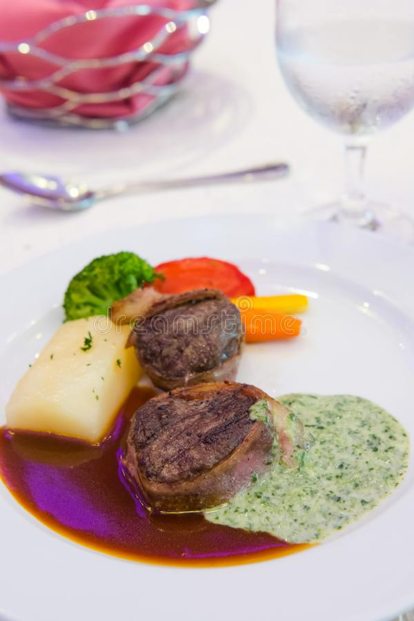 Filet mignon with fresh greens stock images