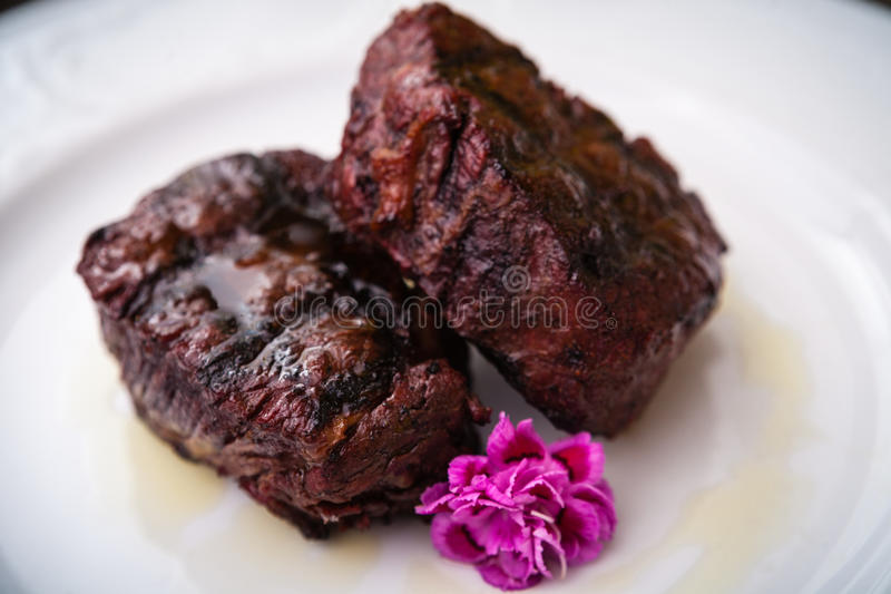 Filet mignon meal. Filet mignon served on a plate in restaurant royalty free stock image