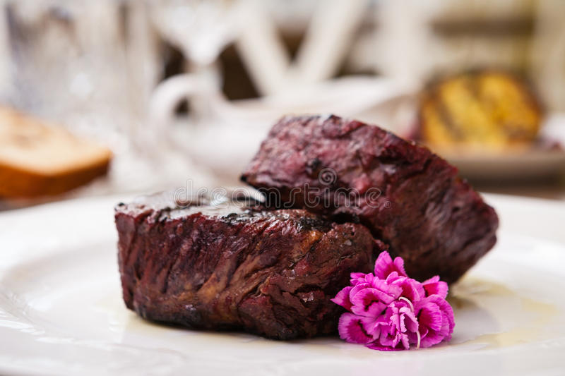 Filet mignon meal. Filet mignon served on a plate in restaurant royalty free stock images