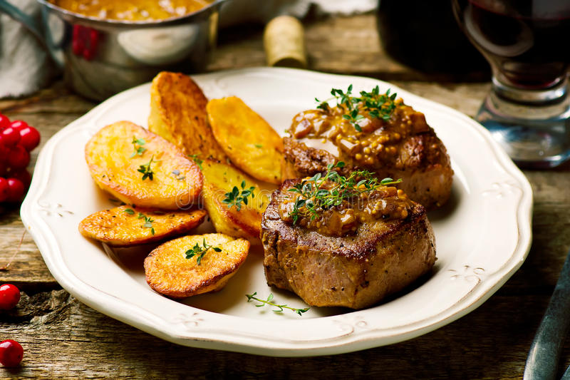 Filet Mignon with a Mustard Sauce stock image