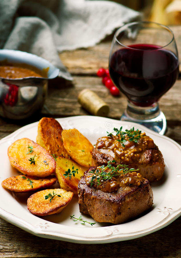 Filet Mignon with a Mustard Sauce stock photo