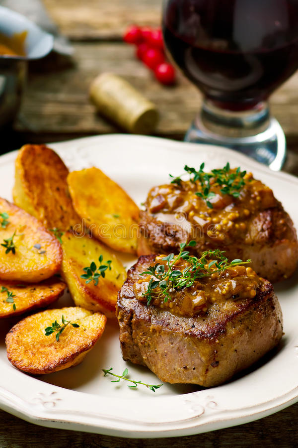 Filet Mignon with a Mustard Sauce. Selective focus royalty free stock photos