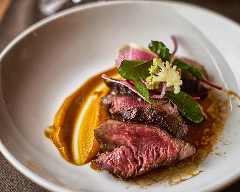 Filet Mignon with Puree in White Bowl royalty free stock image