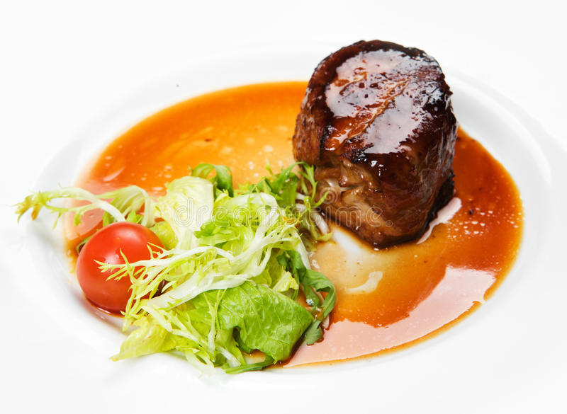 Filet mignon with vegetables. On a white plate stock photo