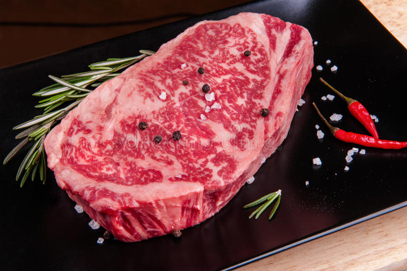 Filet steak. Fillet steak on the black plate royalty free stock images
