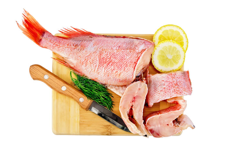 Filet van overzeese baarzen met citroen en dille stock afbeelding