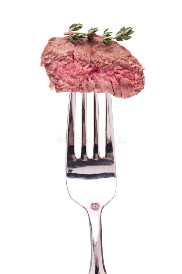 Filet van rundvlees op een vork royalty-vrije stock afbeeldingen