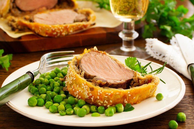 Filet Wellington. Filet Wellington with mushrooms. Selective focus royalty free stock images