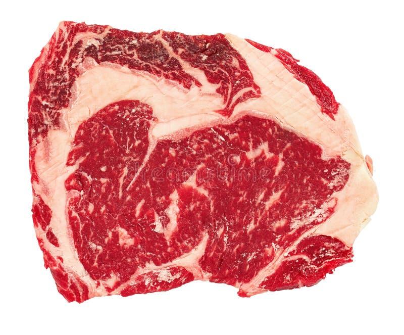 Filete crudo del ojo de la costilla de carne de vaca aislado en el fondo blanco foto de archivo libre de regalías