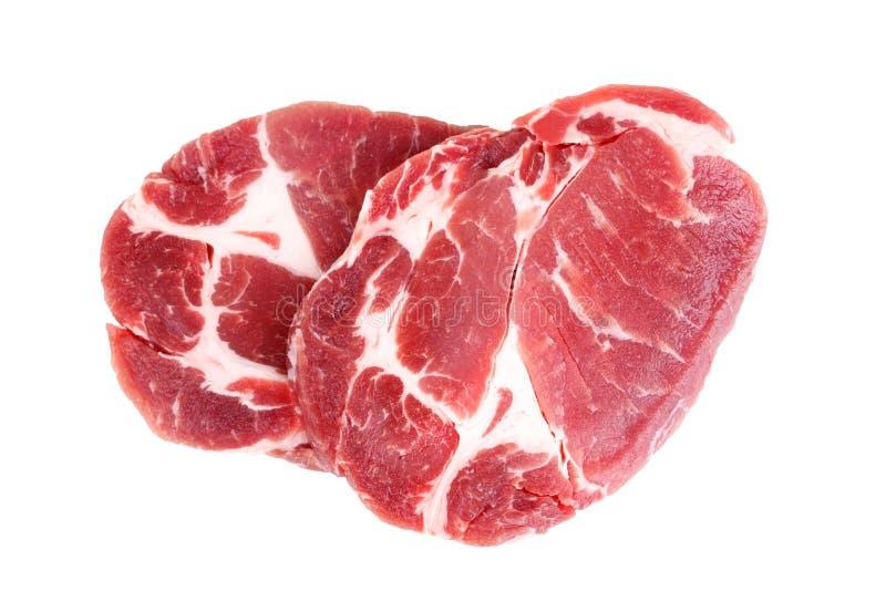 Filete crudo fresco de la carne del cuello del cerdo aislado en el fondo blanco imagen de archivo libre de regalías