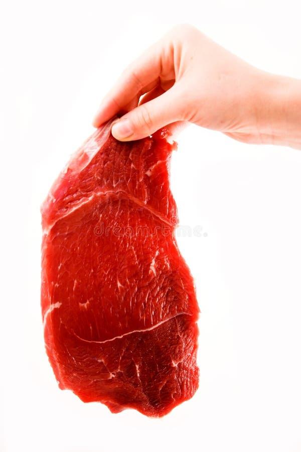 Filete de carne de vaca de la explotación agrícola de la mano imagen de archivo