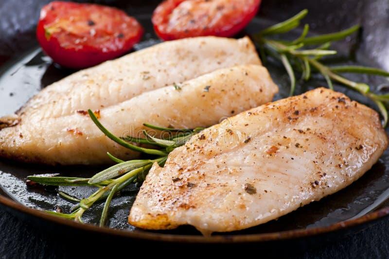 Filete de pescados frito imagenes de archivo