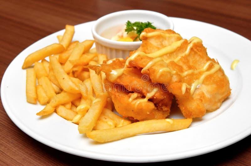 Filets de poissons et pommes frites frits images libres de droits