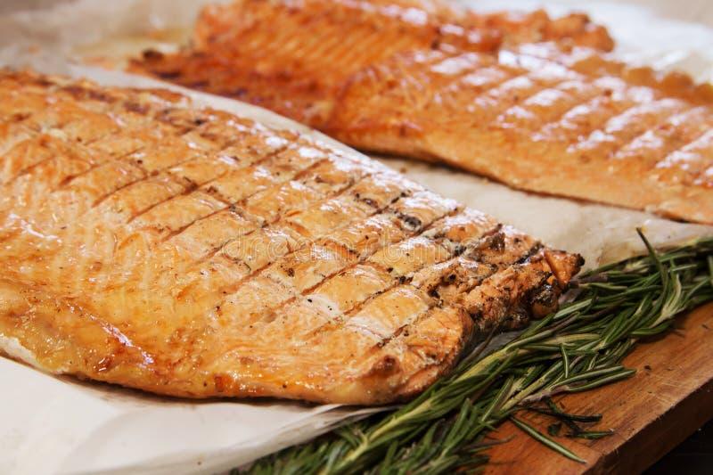 Filetti di pesce cotti fotografie stock