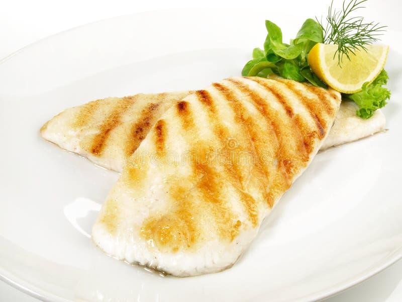 Filetto di pesce arrostito della passera di mare immagini stock