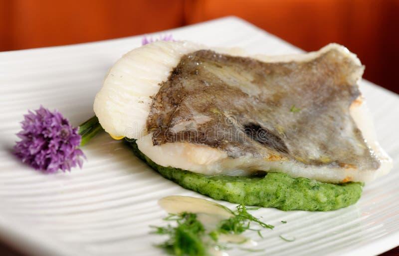 Filetto di pesce di John Dory su spinaci immagine stock libera da diritti